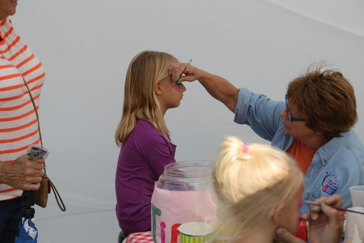 girl having her face painted