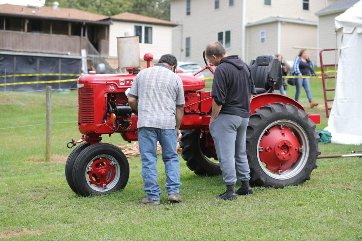people looking at tractor