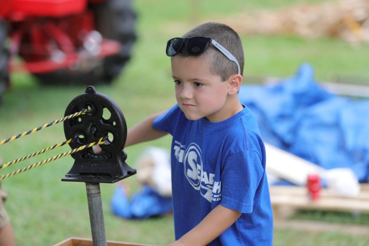 little boy with machine